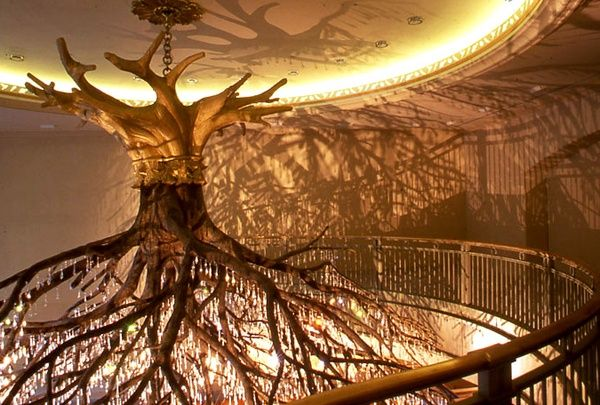 Wow.  Upside down polished bare tree as a chandelier.  This one also has hundreds of chandelier glass/crystal prisms hanging from it.  Just gorgeous.