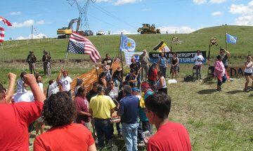 YES. Native American Protesters Halt Pipeline Construction Near North Dakota…