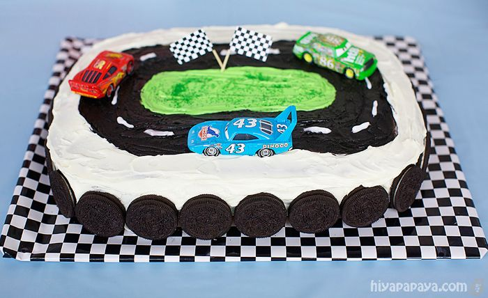 Cars Themed Birthday Party - Race Track Cake (wrapping paper covering cookie sheet. Use toy cars that child already has to go on top.)