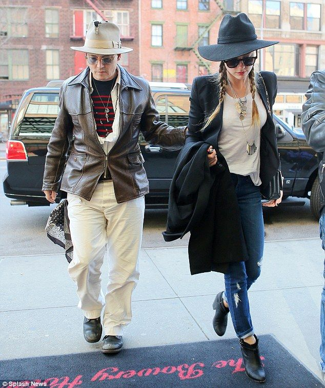 Downcast: Johnny Depp and Amber Heard looked a bit sombre as they strolled into the Bowery...