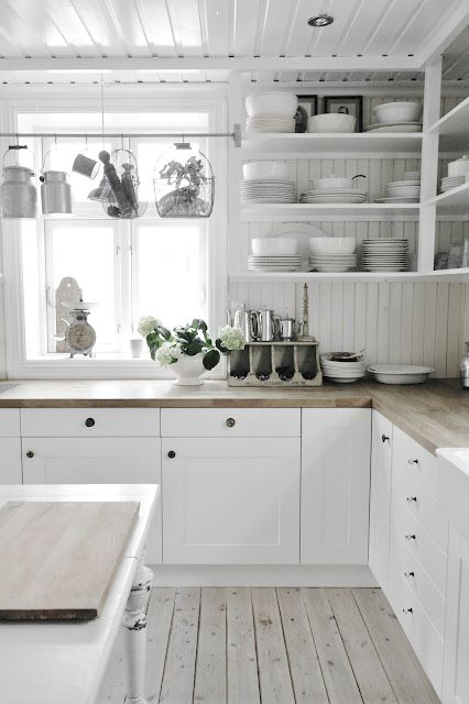 = white, wood, open shelves and hung wire baskets