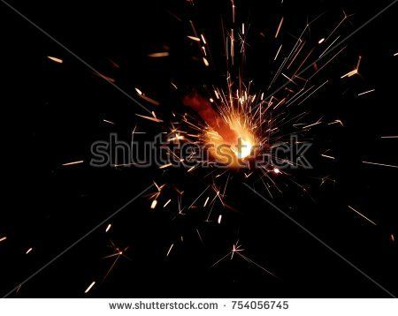 New Year Bengal lights with sparks on a black background