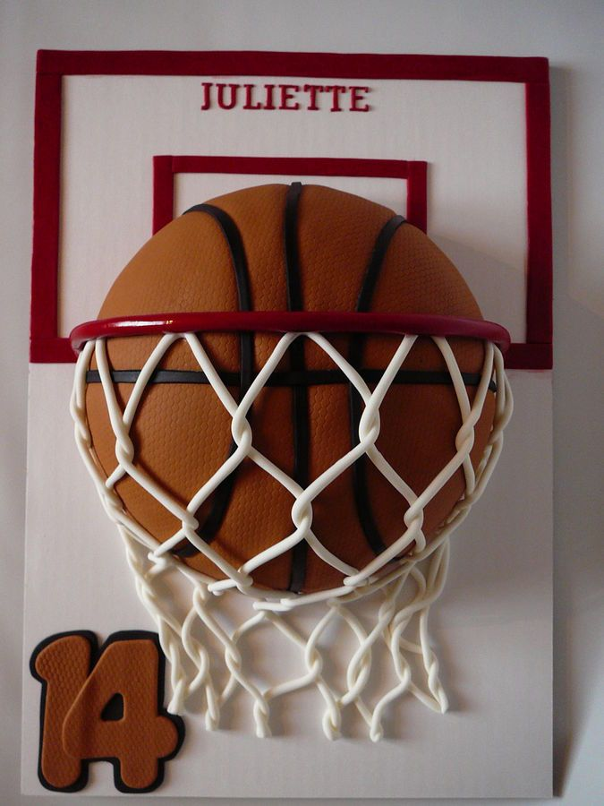 A basketball cake for Juliette 14 years old. She plays basketball and she loves it. This is a marble cake with chocolate ganache filling all covered with fondant. The decorations, letters, numbers, basket... are also fondant. I used tulle fabric to embossed the ball so it looks like leather.