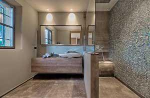 """Realisations • Dothy Design  Création d'une salle de bain, tons beiges  Mosaïque et meuble suspendu """"Sable d'Or"""" Cogolin Mur douche en mosaïque, ciel de pluie, paroi vitrée"""