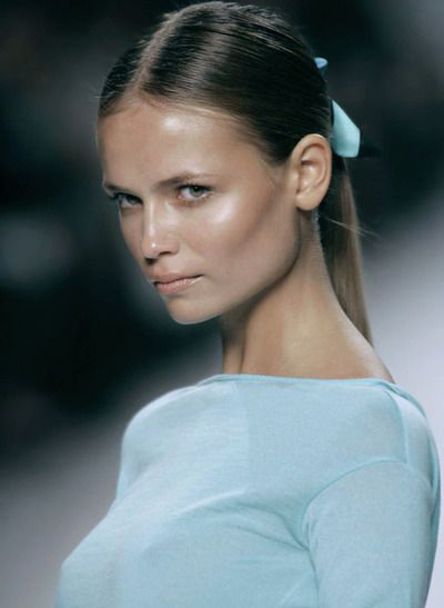 Natasha Poly, in pale blue style.
