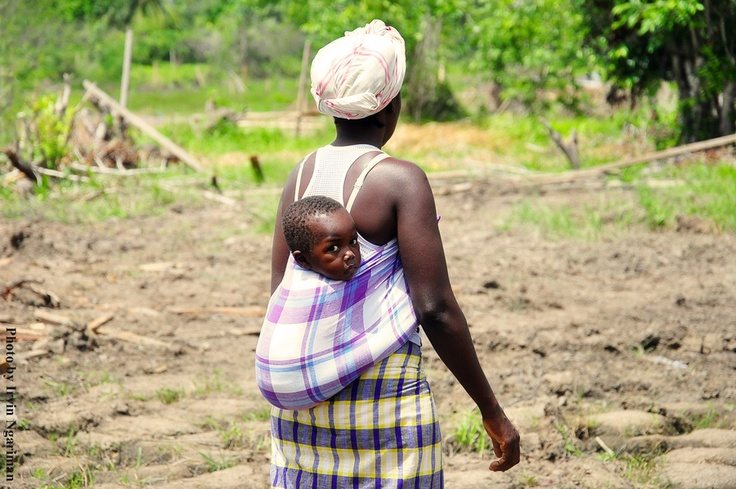 Mother and child at Goedeverwachting, Suriname... Their home was just ruined by the government...
