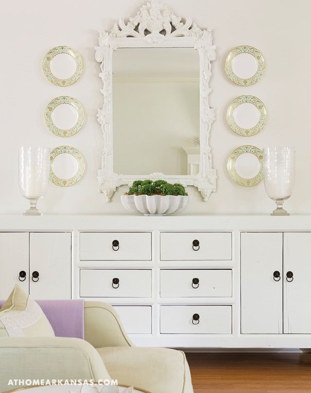 A Painted Sideboard Sits Along Shared Wall In The Dining And Living Room Area