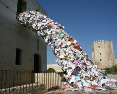 Alicia Martin's art installation appears to be a swell of books pouring from a library window onto the ground below.