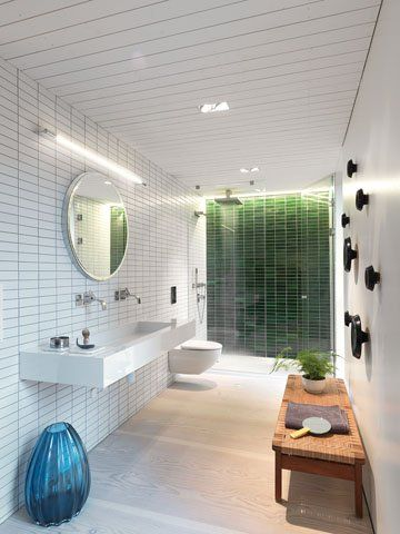 <strong>Photography by Bent René Synnevåg</strong><br>The master bathroom features green tiles from California's Heath Ceramics