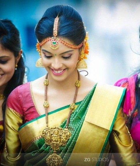 South Indian bride. Gold temple bridal jewelry. Jhumkis.Red kanchipuram sari with contrast green blouse.Braid with fresh jasmine flowers. Tamil bride. Telugu bride. Kannada bride. Hindu bride. Malayalee bride.Kerala bride.South Indian wedding