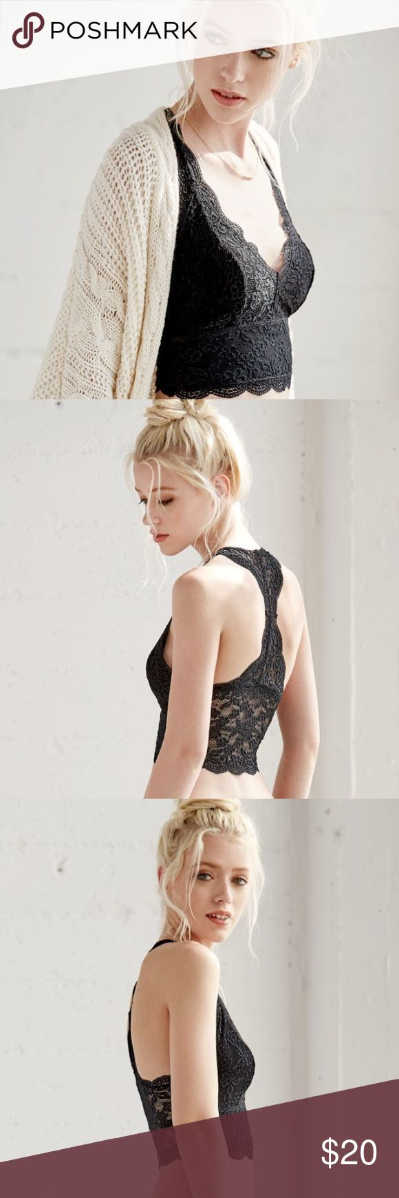 Me To We Lace Racerback Black Bralette Features a delicate lace fabrication, racerback silhouette and scalloped hemline. Wear this beautiful racerback bralette with basic tees and jeans, or when lounging around the house in soft shorts.  Lined; Unpadded Soft lace fabric 90% nylon, 10% spandex; Lining: 100% polyester Machine washable Me to We and PacSun have partnered to support international charity Free The Children, which delivers essential resources that work to break the cycle of poverty…