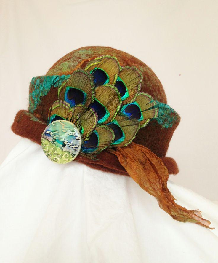 Nuno-felt Peacock feather hat with ceramic button by Dawn Edwards of Felt So Right. www.feltsoright.com