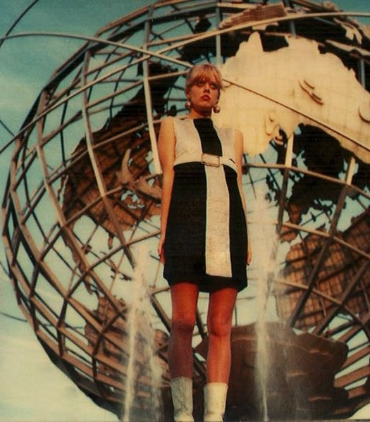 Cindy Wilson standing tall infront of the Unisphere