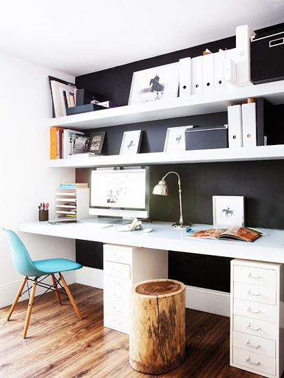 black and white office with white magazine files, filing cabinet, stump stool, and Eames desk chair