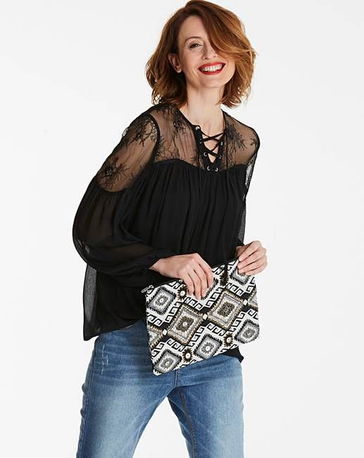 df4b3fe73001d0 This gorgeous lace yoke blouse with lace up detail and a balloon sleeve