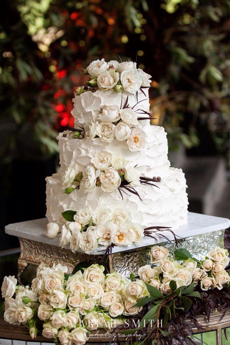 A gorgeous white wedding cake with white