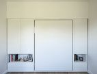 The couple's Murphy bed, Clei's Penelope model, folds up into the wall.  Photo by: Matthew Williams