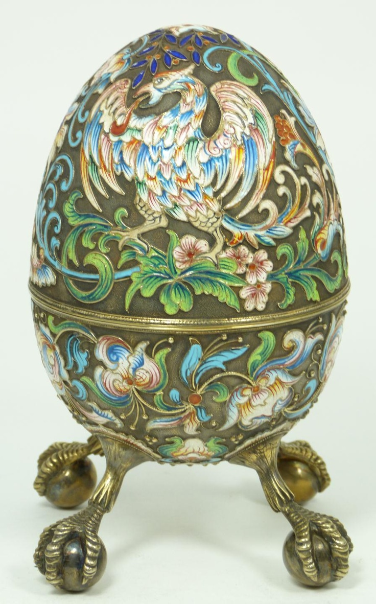 Russian silver footed egg box having scrolled floral design throughout with eagles. Has four attached figural eagle feet clutching sphere. Gold wash interior.