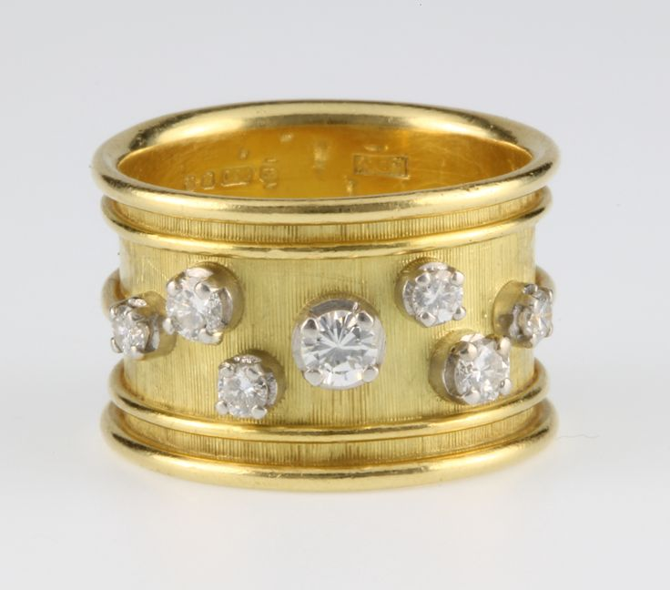 Lot 943, An 18ct yellow gold 7 stone diamond etruscan style ring, 10 grams, size N, est  £350-450