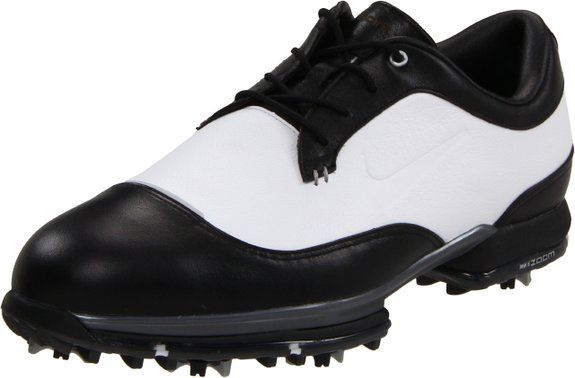 Made from leather with a manmade sole these mens tour premium golf shoes by Nike feature perforated, waterproof leather and contoured sockliner