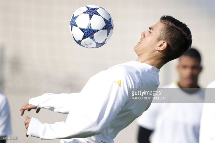 Juventus' forward Paulo Dybala from Argentina takes part in a training session on the eve of the UEFA Champions League football match Juventus Vs FC Porto on March 13, 2017 at the 'Juventus Training Center' in Vinovo, near Turin. / AFP PHOTO / Marco BERTORELLO
