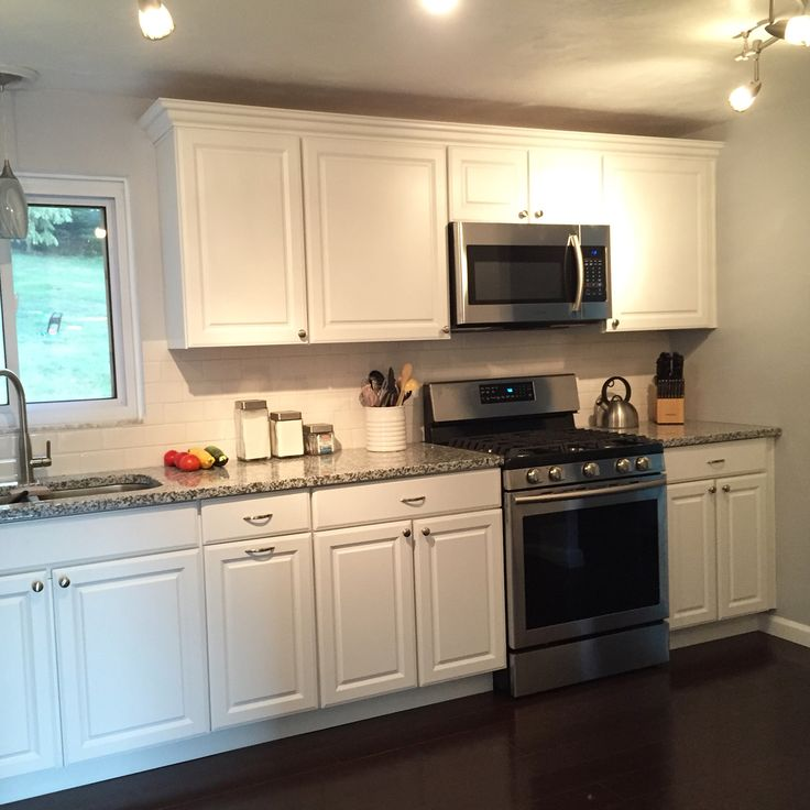 Loving our white cabinets Luna Pearl granite countertops