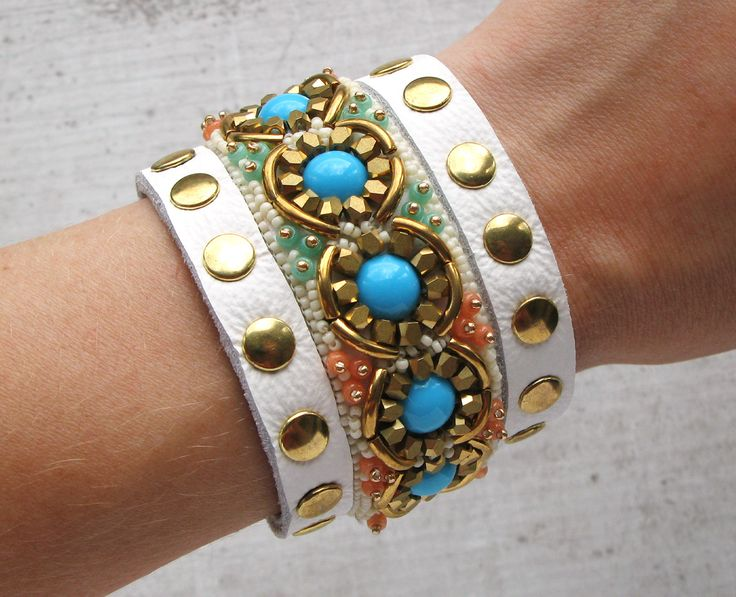 White/Turquoise leather bracelet with rivets.