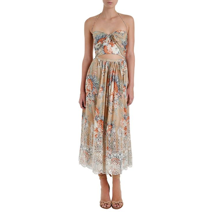 Anais antique floral dress by Zimmermann - tie front bodice with cut-out detail and scalloped broidery hem. shoestring halter strap neck tie. dress falls to mid calf.