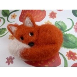 curled up needle felted fox