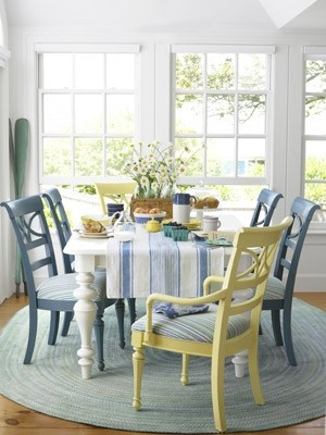 Cute dining room chairs - love the pale yellow and blue chairs as accents to all the white