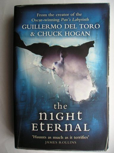 "The novel ""The Night Eternal"" by Guillermo del Toro and Chuck Hogan was published for the first time in 2011. It's the third novel in the Strain trilogy and is the sequel to ""The Fall"". Cover art: Renee Kelly/Getty Images (vampire), Chen Chao/Getty Images (bus), Shutterstock (broken glass) for a British edition. Click to read a review of this novel!"