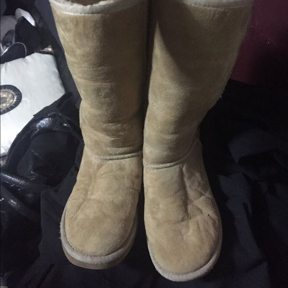 Ugg boots  It has a hole near the sticking as shown on the last photo but it's barely noticeable. Has stains also in some spots like little tiny dots of black paints ️Etc still in great condition ☺️ SOLD AS IS. UGG Shoes Winter & Rain Boots