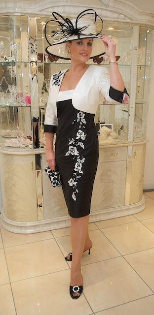 With this lovely fashion combination...you are perfect styled up for a horserace..a wedding...a more exculusive gardenparty....love the play of the black and the white...