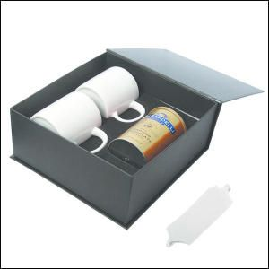 Hot Chocolate With Mugs Gift Set. Warm up cold evenings with this great gift! Includes one Ghirardelli hot cocoa mix along with two CM8414 mugs. The mugs hold up to 450 ml. (15 oz.) each and are Ceramic with a glossy finish. They have a large ergonomic  C' handle, are BPA free, FDA compliant and dishwasher safe. Gift boxed with ribbon. Seasonal item, hot chocolate packaging may change.