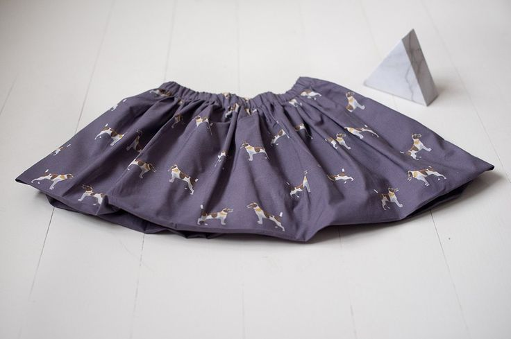 Foxterier Print skirt in a beautiful plum color shade. Modern, simply with a touch of joyful irony.  Inspired by an authentical and unique, child friendly dog called Atchoum... ju-inspiration.com