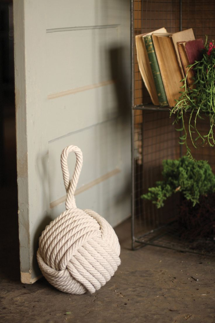"Nautically inspired, this cotton rope door stopper is weighty enough to hold open your door in style. Product Description • Product Dimensions: 10"" D x 16"" T • Material: Rope • Sold in Boxes of: 1 Eac"