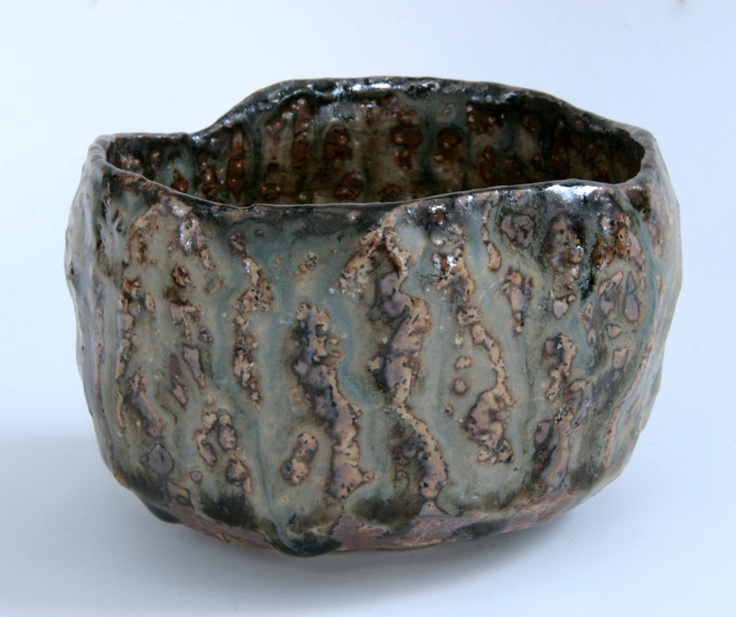 Pinched and carved tea bowl with ochre slip, blue pigment and cedar ash glaze