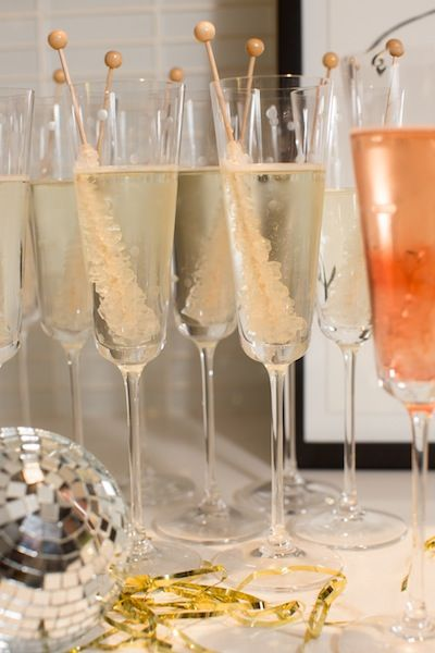 Gimme some sugar.    Rock candy stir sticks add whimsy and decadence to flutes of champagne…this is one night when nothing should be taken too seriously!    kate spade new york larabee dot flutes
