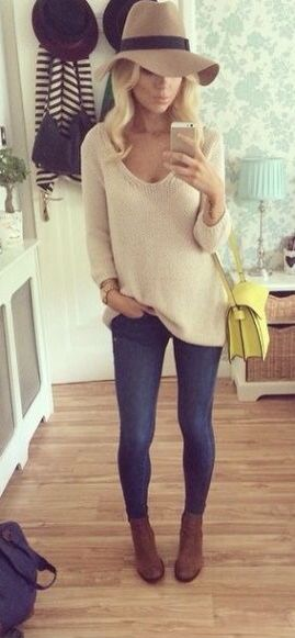 Love this outfit, awesome jeans, lovely boots and sweater and even that hat is nice. And hair is perfectly wavy and blonde.