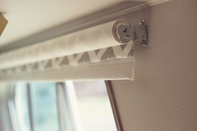 The roller blinds, cover the front with fabric. Use a 3M adhesive spray and adhered the fabric to the blind.