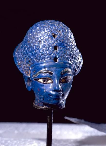 Miniature blue glass paste head of the King Amenhotep III, wearing the blue war crown. New Kingdom 18th Dynasty c.a. 1390-1352 B.C.