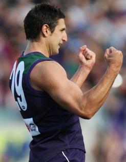 Club champ Pav makes history - AFL.com.au