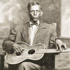 Charley Patton an Howlin' Wolf | The two became acquainted and soon Patton was teaching him guitar.