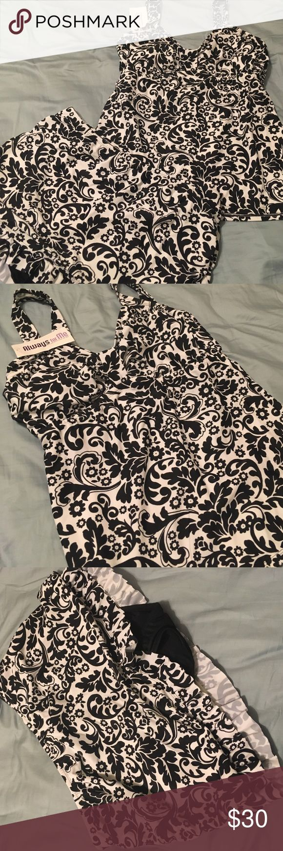 Always For Me Tankini! Chic Print! Ready for the summer? This lovely two piece black and white floral print swim suit is the ticket! The suit is new, never worn. The bottom is a swim skirt. Always For Me Swim