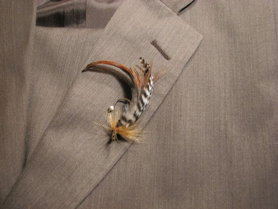 Tyler loves these ones. He said that he would wear it for sure. And you can get custom colors :) TIE FLY Boutonnieres & Accessories~Specialty Design Service For Weddings-Events. Custom, Hand-Crafted Fly Fishing Boutonnieres-Accessories~