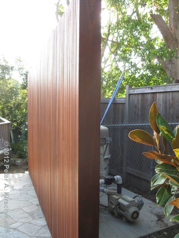 Closeup of modern style pool equipment enclosure built for Gardens pool supply