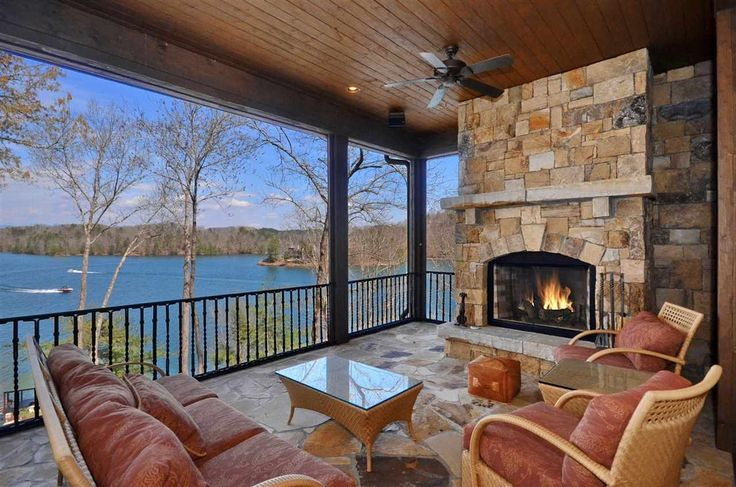 Craftsman Porch with exterior stone floors, Wrap around porch, outdoor pizza oven