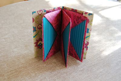 How to Make a Blizzard Book.  Also see on YouTube:  http://www.youtube.com/watch?v=jyHoW-d-e0o  AND:  http://webalstrom.ftml.net/bookworks/workshops/samples/documents/blizzard_book_instructions.pdf