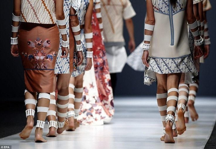 Danny Satriadi sent models out in deconstructed garments, with their hands and legs covered in fabric cuffs.