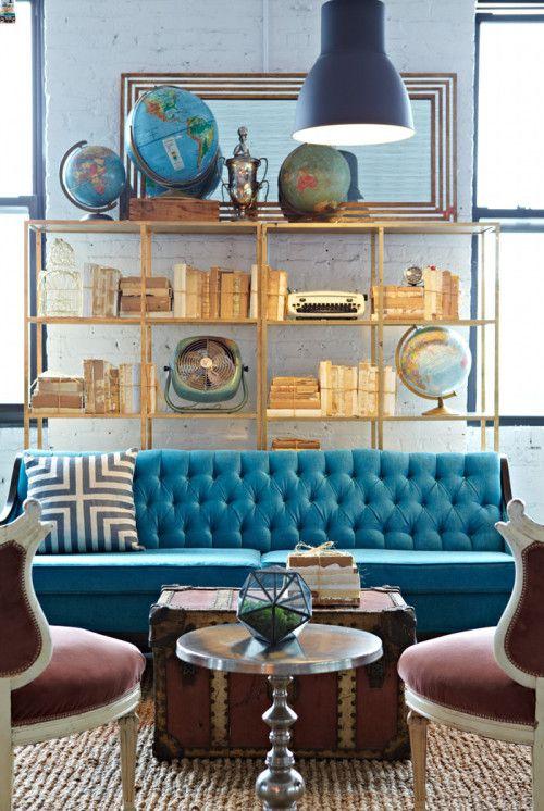 A Brooklyn prop rental studio set up like a living room (Love that blue sofa!)